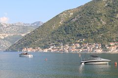 Morning in the Bay of Kotor in Montenegro. Two boats Stock Photos