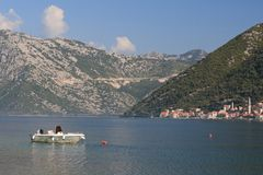 Morning in the Bay of Kotor in Montenegro. White boat Royalty Free Stock Photos