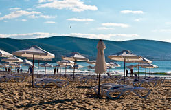 Morning beach. View of the beach with loungers and umbrellas stock images