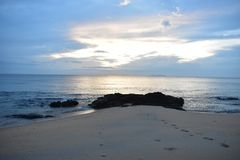 Morning beach with footprints on the sands Stock Photography