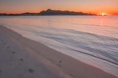 Morning by the beach. Playa de Muro, sunrise sky in background