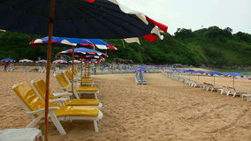 Morning beach. Sun umbrellas and chaise longues on Naiharn beach, Phuket, Thailand stock footage