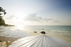 Morning Beach with sunshine and beach umbrella with chair on tropical island. Samet. Thailand Stock Photo