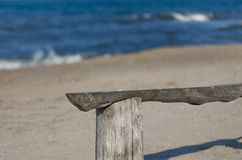 Morning beach waves. Sunrise sand bench in the foreground royalty free stock photography