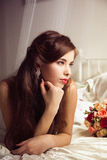 Morning of beautiful bride in the bed Royalty Free Stock Image
