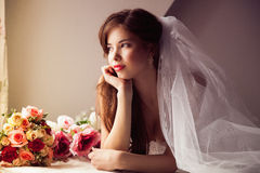 Morning of beautiful bride looking at the window Royalty Free Stock Photo