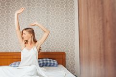 In the morning a beautiful girl in the bedroom who woke up and r royalty free stock images
