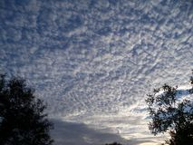 Mackerel sky early in the morning. Morning and a beautiful mackerel sky just after sunrise stock photo