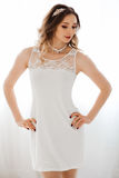 Morning of beautiful sensuality woman in short white dress. Royalty Free Stock Photos