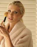 Morning Beauty. Woman applying cosmetics in the morning Stock Photography