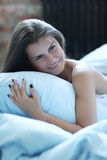 Morning in bed. Beauty. Beautiful woman in lingerie Royalty Free Stock Images