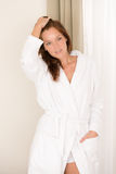 Morning bedroom - woman in bathrobe Royalty Free Stock Photography