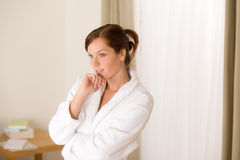 Morning bedroom - woman in bathrobe Royalty Free Stock Photo