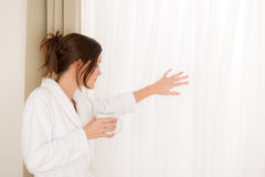 Morning bedroom - woman in bathrobe with coffee Stock Image