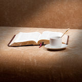 Morning Bible reading. Morning coffee with the Bible in background Royalty Free Stock Photo