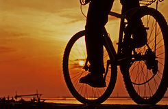 Morning Bike. Morning life with bike is fun at seashore Stock Images
