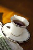 Morning black tea. With newspaper stock photo