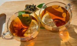 Morning black tea with lemon Stock Photos