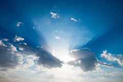 Morning sky with natural sun rays. Morning blue sky with clouds and natural sun rays Royalty Free Stock Image