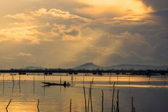 Morning of Boatman in Sonkla Lake stock images