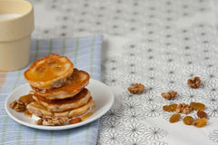 The morning brakfast. Pancakes with nuts and milk Royalty Free Stock Photo
