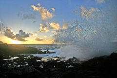 Morning Breaker. Sunrise on Poipu, Kauaii.  Shot right before this crashing wave soaked me... refreshing Stock Photo
