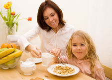 Morning breakfast. Mother and her daughter have a Royalty Free Stock Photos