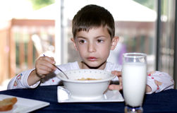 Morning breakfast. 6 year old boy having breakfast in the morning stock photography