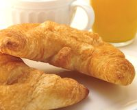 Morning Breakfast. Early morning breakfast with couissant Orange Juice and coffee.wake up Stock Image