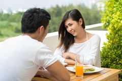 Morning breakfast on the balcony. Image of a young couple having morning breakfast on the balcony of their apartment Stock Image