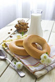 Morning breakfast. Of biscuits, milk, bagels on the table Royalty Free Stock Photography