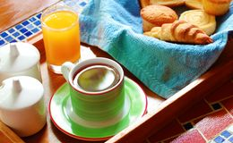 Morning breakfast or brunch with bread & coffee. Morning wholesome breakfast or brunch on table with freshly brewed hot beverage (coffee) and continental Stock Photo