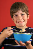 Morning breakfast cereal. Shot of a kid enjoying morning breakfast cereal royalty free stock photo