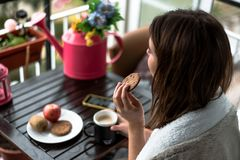 Cookies and cup of tea for breakfast stock image