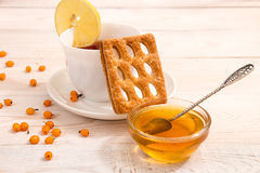 Morning breakfast. Cup of tea with lemon, cookie with delicious Stock Photos