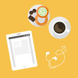Morning breakfast day planning. Tablet pc on table and cup of coffee. Stock Photo