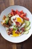 Morning Breakfast. Eggs over medium, tomato, avocado, bacon, and potatoes Stock Image