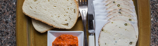 Morning breakfast of fresh bread and salami, top view Royalty Free Stock Photos