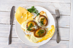 Morning breakfast with fried eggs and hard cheese. Top view. Morning breakfast with fried eggs and hard cheese. Serving breakfast Royalty Free Stock Images