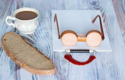 Morning Breakfast in a good mood. Sausage laid on the table in the form of glasses royalty free stock photos