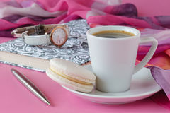 Morning breakfast for her French macaroon and coffee Stock Photos