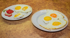 Morning breakfast at home. 2. Fried eggs on a plate cooked in the morning at home stock photos