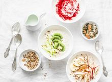 Morning breakfast inspiration - coconut overnight oatmeal with various topping. Healthy gluten free food concept. Top view. Flat lay Royalty Free Stock Photo