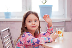 Morning Breakfast in the kitchen a little girl stock photo