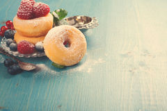 Morning breakfast with mini donuts and berries Royalty Free Stock Images