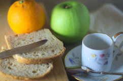 Morning breakfast in natural light. On a wooden rustic table with fruits Royalty Free Stock Photography