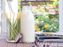 Morning with breakfast and newspaper,soy milk and  biscuit on th. E table Stock Image