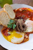 Morning Breakfast. Over medium eggs, sausage, and bread Royalty Free Stock Images