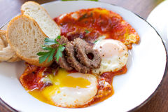 Morning Breakfast. Over medium eggs, sausage, and bread Stock Photography