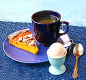 Morning breakfast with pumpkin pie and egg Stock Images